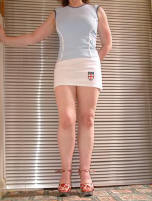 12 inch white mini sports skirt with shield logo